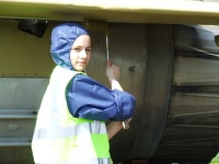 Mig restoration team member Miss Kaye Watson at Newark today 5-5-08 painting under-side of tailplane, port side with 'Buff-primer'. Well done Kaye Marie, helped big-time. Kaye is 18 years old and allowed to work on the project with the team.